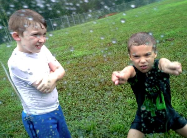 Real men play football in the rain.   jennie creates